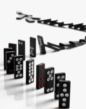 Falling dominoes in a chain reaction